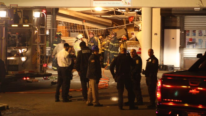 A woman was injured Tuesday, March 25, 2014, after she crashed a Toyota through the front of the Eben Ezer Caribbean Bakery in the South Central Plaza, Spring Valley.