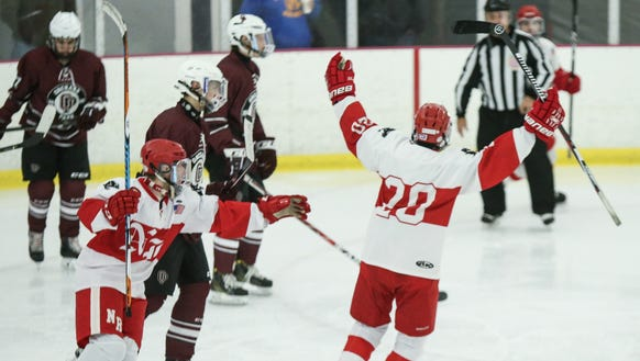 North Rockland's Luke Morris (20) celebrates a goal
