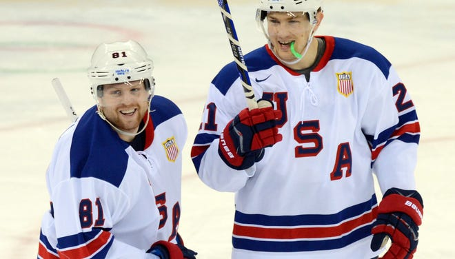 USA forward Phil Kessel (81) celebrates with forward James van Riemsdyk (21) after scoring his second goal of the first period against Slovenia.