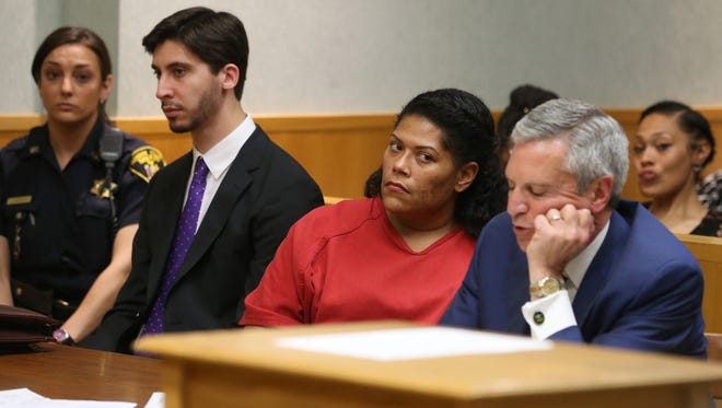 Rochester City Court Judge Leticia Astacio, seated center, with her attorney, Edward Fiandach, seated right, listen as she is found guilty of breaking the conditions of her DWI sentence during her hearing at the Hall of Justice in Rochester Thursday, June 8, 2017.