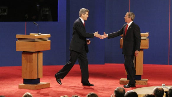 George W. Bush and John Kerry shake hands at the beginning