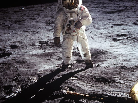 "Astronaut Buzz Aldrin, lunar module pilot, walks on the surface of the Moon near the leg of the lunar module ""Eagle"" during the Apollo 11 extravehicular activity. Astronaut Neil A. Armstrong, commander, took this photograph with a 70mm lunar surface camera. While astronauts Armstrong and Aldrin descended in the lunar module to explore the Moon's Sea of Tranquility region, astronaut Michael Collins remained with the command and service modules ""Columbia"" in lunar orbit."