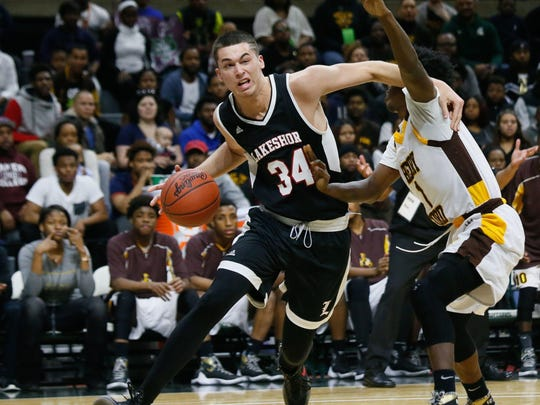 Stevensville Lakeshore's Braden Burke cuts to the basket against Detroit Henry Ford's Jeremy Crawley during Henry Ford's 61-47 win in the Class B state final Saturday in East Lansing.