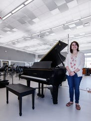 Band Director Emma Angoli stands in the new Band Room