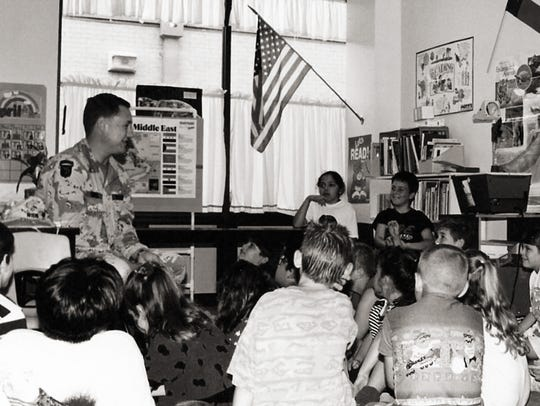 Stephen Wiehe talks with an elementary school class