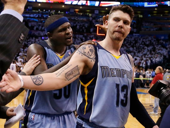 Memphis Grizzlies forward Zach Randolph (50) pats teammate