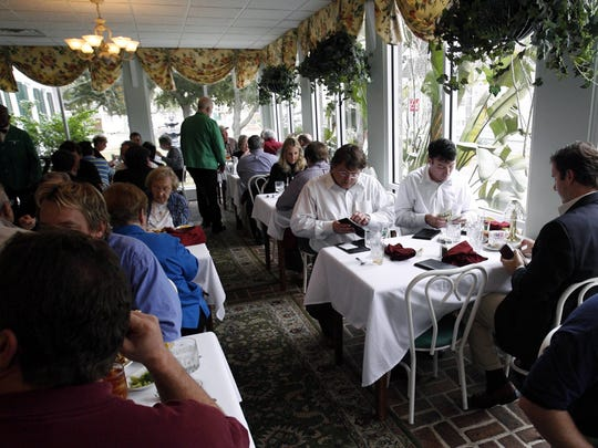In this 2008 photo, diners enjoy lunch in the sun room at Mary Mahoney's Old French House restaurant in Biloxi. The restaurant open on May 7, 1964.
