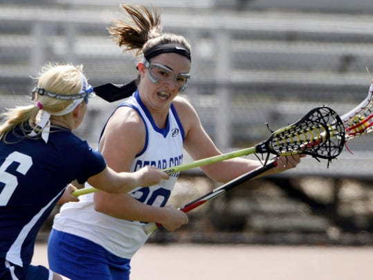 Cedar Crest's Alex Rich looks to get by West York's Amanda Lehman during a non-league game at Earl Boltz Stadium on Saturday. Crest defeated West York, 15-13.