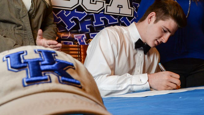 Chance Poore signs his letter of intent to play for UK in 2017.