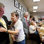 Rep. Charles Busby, R-Pascagoula, front left, is thanked by Edna McDaniel, a member of the Singing River Health System HOPES Retirees Group from Pascagoula, after presenting a bill designed to bring more transparency to the way publicly owned hospitals are run.