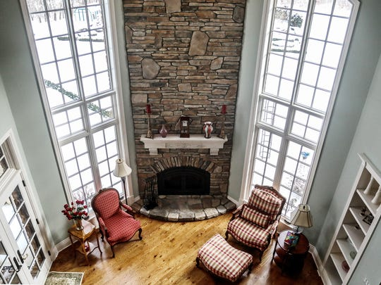 Stone continues as a theme. It forms a two-story fireplace