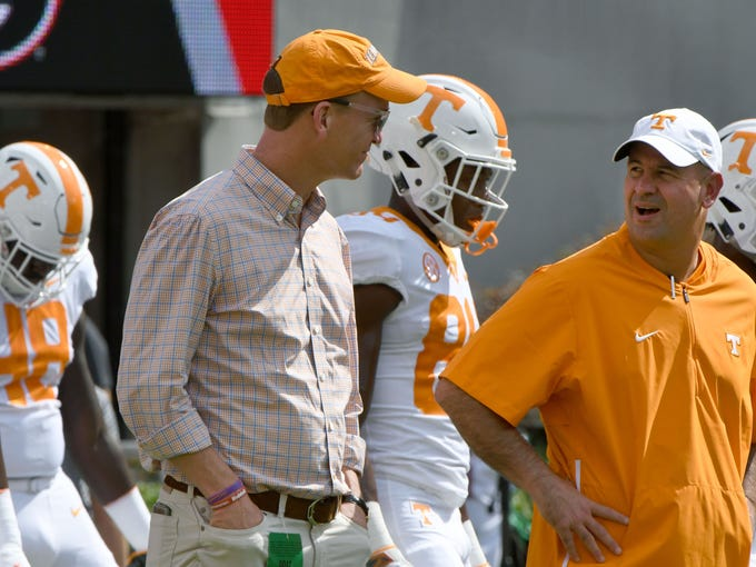 Peyton Manning talks to Tennessee Head Coach Jeremy