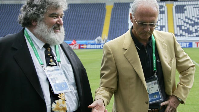 Chuck Blazer, left, walks with German soccer legend Franz Beckenbauer at Frankfurt, Germany's Waldstadion Stadium in 2005. Blazer admitted taking bribes for votes on where the 1998 and 2010 World Cups would be held.