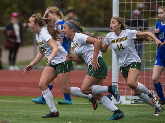 Burr and Burton's Grace Pinkus, center, celebrates her game-winning goal in overtime against Colchester with Emma Perry, left, and Brooke Woodard during the Division I girls soccer state championship game in Burlington on Saturday.