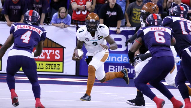 Darron Thomas of the Arizona Rattlers looks for running room against J'Vontez Blackmon of the Storm during Saturday's United Bowl at the Premiere Center.