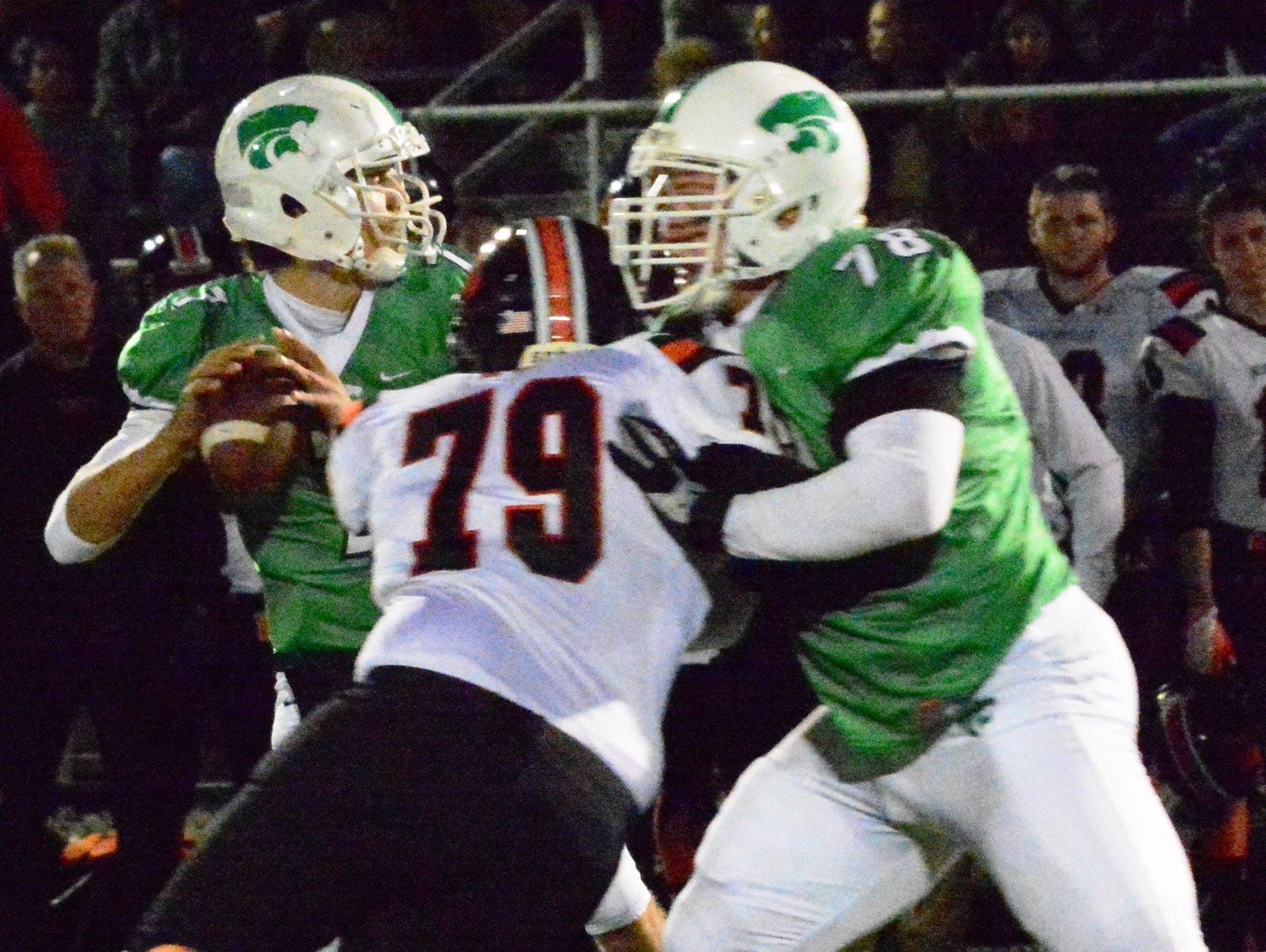 Novi quarterback Alec Bageris (left) sets up to throw before Northville's Jacob Randall (79) moves in for the sack while being blocked by Adam Guirey (right).