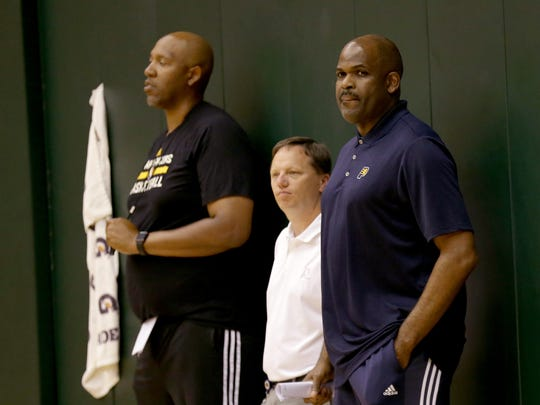 Indiana Pacers head coach Nate McMillan,right, watches the six college players work out. The Indiana Pacers held another pre draft workout for several possible NBA draft pick at Monday, June 5, 2017, afternoon at Bankers Life Fieldhouse.