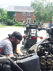 Stephan Junghans swaps parts between his two 1980s-era motorcycles Wednesday at his home at Larkin Terrace extended-stay hotel in South Burlington. Photographed June 21, 2017.