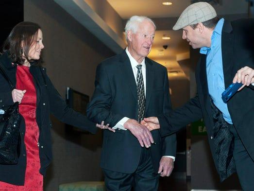 Hockey legend Gordie Howe speaks with a fan as he leaves