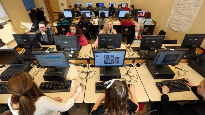 Seventh grade students in Ellen Mason's computer class work on a project at Little Miami Middle School, in this 2013 file photo. The Little Miami School District and other districts at the time were working through the logistics of switching from paper-pencil to computers for state tests.