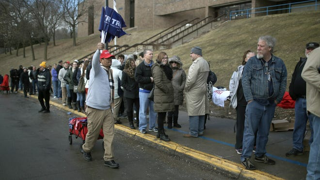 A vendor sells Trump merchandise as  people wait in line to see Republican presidential candidate Donald Trump speak to guests during a campaign rally at the Gerald W. Kirn Middle School on January 31, 2016 in Council Bluffs, Iowa. Trump and other presidential hopefuls are in Iowa trying to gain support and crucial votes for tomorrow's caucuses.