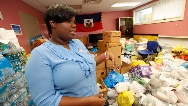 Wendy Boisrond of Chestnut Ridge, has seen first hand the damage done to her homeland at the HACSO Community Center in Spring Valley on Oct. 20, 2016.  She is helping with the food drive that the center is organizing which will go to Haiti relief efforts.