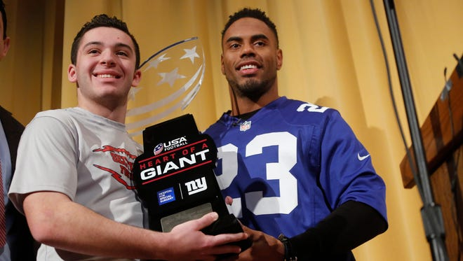 Mahopac High School senior Charlie Burt and New York Giants running back Rashad Jennings at a presentation ceremony where Burt was given the Heart of a Giant award on Dec. 12, 2016.