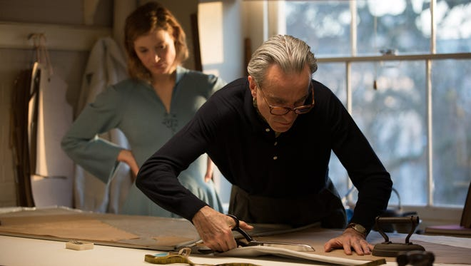 Reynolds Woodcock (Daniel Day-Lewis, right) designs a gown for his new lover and muse, Alma (Vicky Krieps).