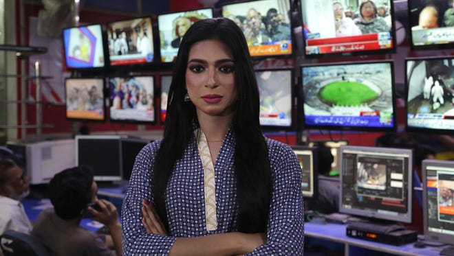 In this photo taken on Tuesday, March 27, 2018, Pakistan's first transgender newscaster Marvia Malik poses for a photo in a control room of a local television channel in Lahore, Pakistan.