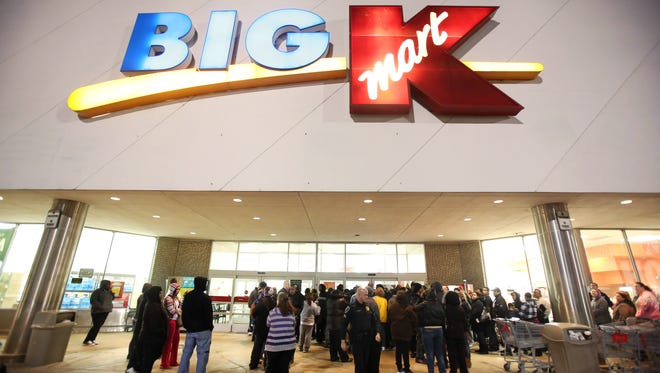 Shoppers wait for a Kmart to open on Thanksgiving night, 2012.