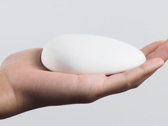 The bluetooth-enabled, egg-shaped Smart Nora device  sits on a nightstand.