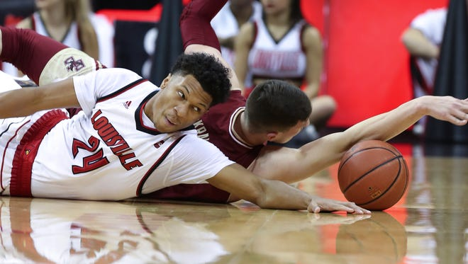 U of L's Dwayne Sutton (24) scrambles for a loose ball against Boston College's Luka Kraljevic (13) during their game at the KFC Yum! Center.  Jan. 21, 2017