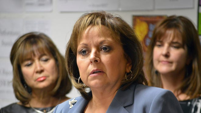 New Mexico Gov. Susana Martinez talks on Jan. 10 to reporters at the Mission Achievement and Success Charter School in Albuquerque.