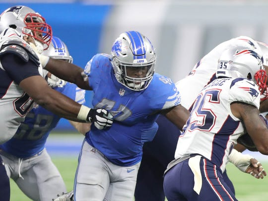 Lions LB Jarrad Davis tackles Patriots RB Mike Gillislee during the first half Friday, Aug. 25, 2017 at Ford Field in Detroit.