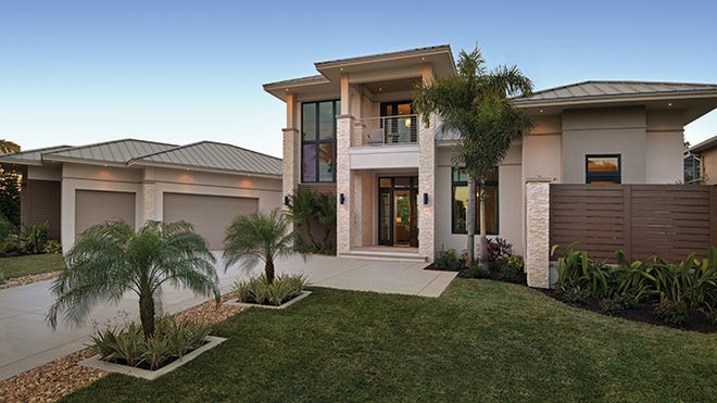 Stucco and stacked stone accents give a modern yet warm appearance to the exterior.