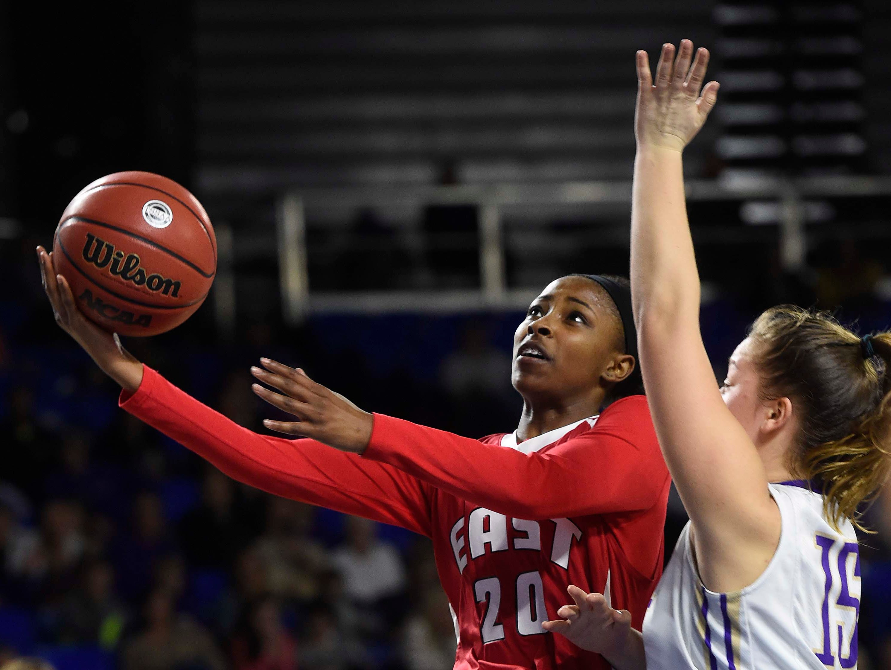 East's Erica Haynes-Overton (20) shoots for two of her 16 points around CPA's Addie Russell Omer (15) as East Nashville wins 47-35 in the Division I Class AA Girl's basketball tournament at the Murphy Center on MTSU's campus March 10, 2016 in Murfreesboro, Tenn.