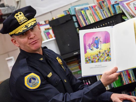 Des Moines police Chief Dana Wingert reads to students at Lovejoy Elementary School  on Wednesday, March 2, 2016, during Read Across America Day at Lovejoy Elementary.