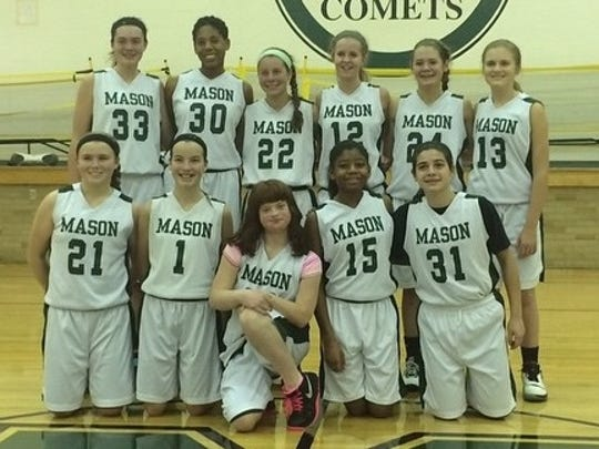 The Mason Middle School eighth-grade girls basketball team featuring, front row center, Mary Scheeler.