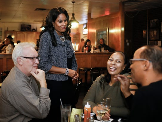 Lansing mayoral candidate Judi Brown Clarke chats with