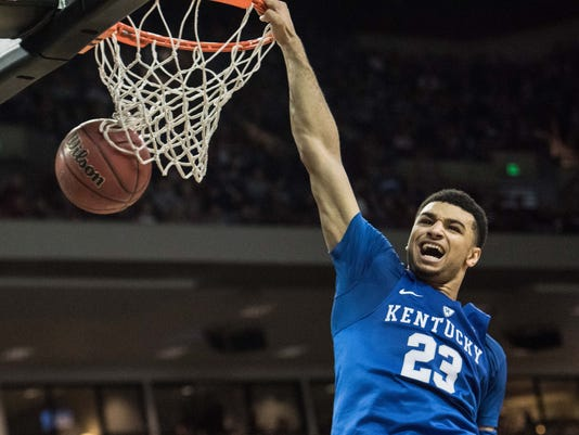 Kentucky guard Jamal Murray (23) dunks the ball during the second half of an NCAA college basketball game against South Carolina Saturday, Feb. 13, 2016, in Columbia, S.C. Kentucky defeated South Carolina 89-62. (AP Photo/Sean Rayford)