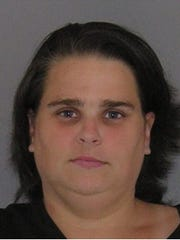 Jamie Carver was arrested and charged with binding and gagging her boyfriend's twin sons, age 4.