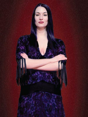 "Erin Cohenour stars as Morticia Addams in Beef & Boards Dinner Theatre's production of ""The Addams Family,"" running Oct. 8-Nov. 22, 2015."