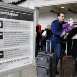 Passengers line up at a TSA security checkpoint at John F. Kennedy International Airport, in New York. Federal agents at airports and borders would be exempt from new racial profiling guidelines.
