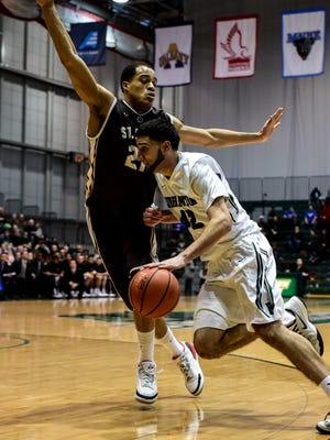 Binghamton's Willie Rodriguez tries to get around St. Bonaventure's Dion Wright during Saturday's mens basketball game at the Events Center.