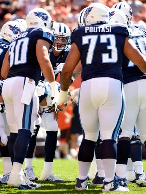 Titans quarterback Marcus Mariota calls a play in the huddle during the first quarter against the Browns, who sacked him seven times.