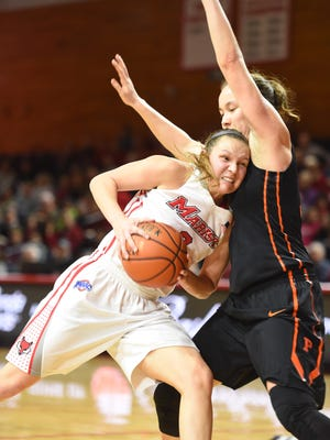 Marist College guard Eileen Van Horn collides with a Princeton defender during their game at McCann Arena on Tuesday.