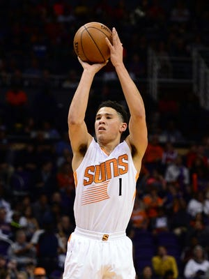 Jan 23, 2016: Phoenix Suns guard Devin Booker (1) shoots the basketball against the Atlanta Hawks in the first half at Talking Stick Resort Arena.