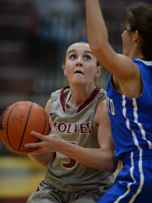 Indiana University East's Kristen Miller looks to score against Alice Lloyd's Bailey O'Bryan during the KIAC basketball tournament Wednesday, Feb. 24, 2016, at Earlham College in Richmond.