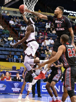 UL's Shawn Long tries to defend a Little Rock guard during the Cajuns' loss to the Trojans on Saturday at Lakefront Arena in New Orleans.