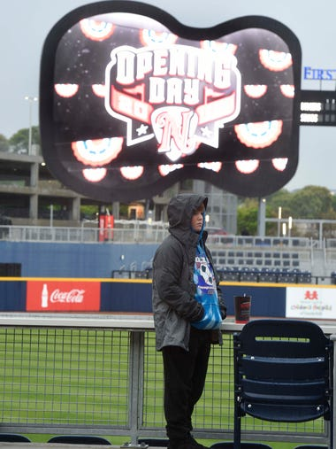 Grady Conlin, 11,  stands in the rain on opening night